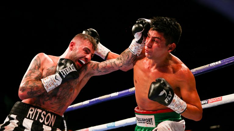 Lewis Ritson lands a left hand as German Benitez counters with a right