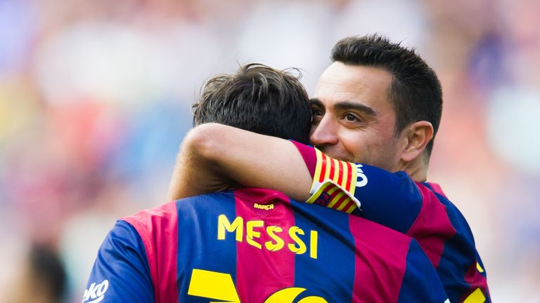 Lionel Messi and Xavi celebrate whilst playing alongside each other at Barcelona