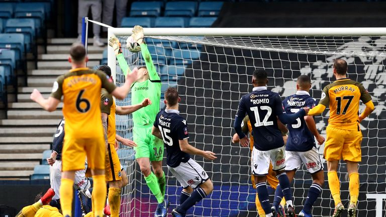 Millwall's David Martin spills the ball into his net