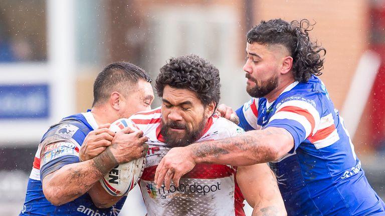 Hull KR's Mose Masoe is tackled by Wakefield's Tinirau Arona & David Fifita