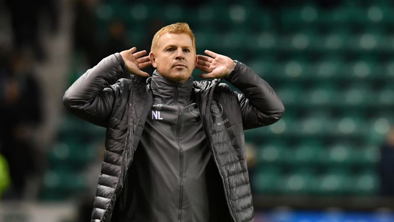 Neil Lennon celebrates in front of the fans at full time