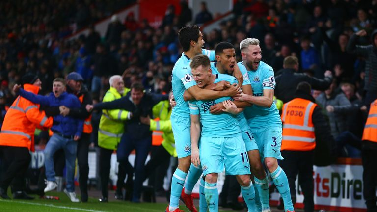 Matt Ritchie celebrates after scoring Newcastle's second goal with his team-mates