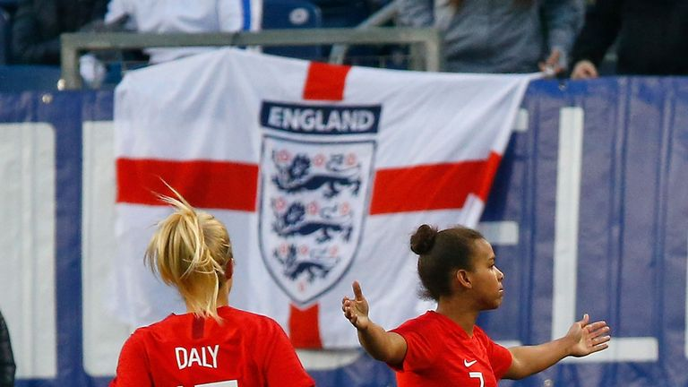 Nikita Parris celebrates England's second goal in their 2-2 draw with the USA in Nashville on Saturday