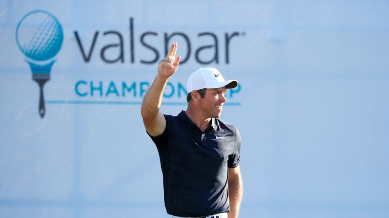 Casey celebrates after tapping in the winning putt at the Valspar Championship