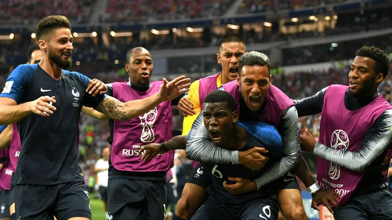 Pogba celebrates with his team-mates after scoring in the World Cup final