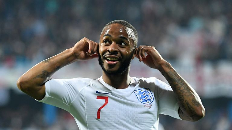 Raheem Sterling responds to the crowd after hearing racist chants in Montenegro