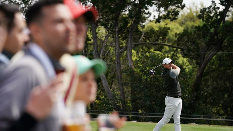 Tiger Woods shrugs off injury scare to sit one off the lead