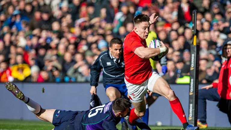 Josh Adams scores a try during Wales' win over Scotland