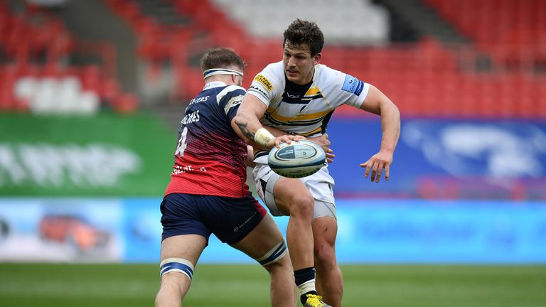 Worcester's  Ryan Mills looks to offload the ball out of the tackle from Ed Holmes