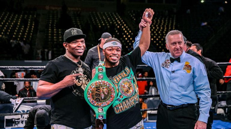 The WBC champion celebrates with his father and trainer Kenny Porter