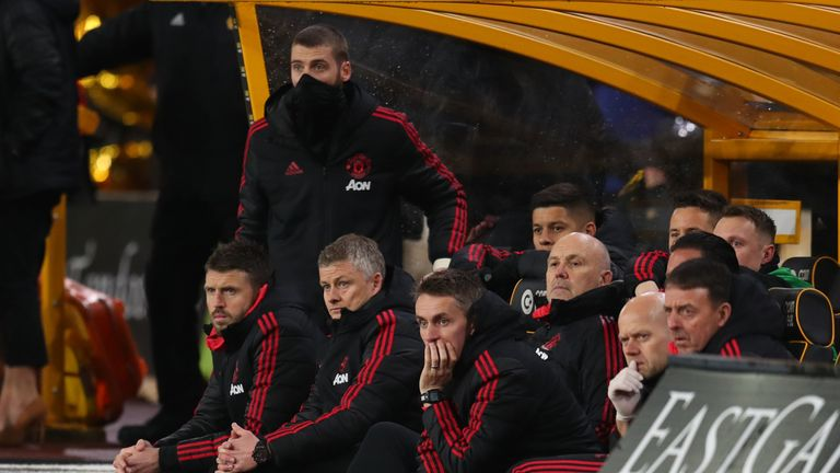 Solskjaer looks on as United were knocked out of the FA Cup at Molineux