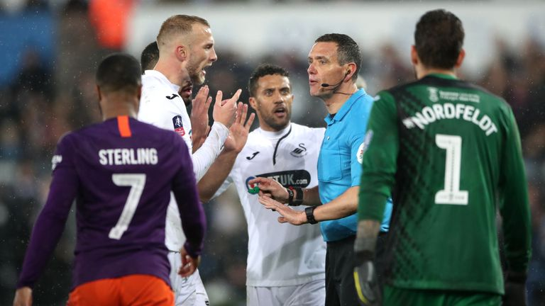 Swansea defender Mike van der Hoorn appeals to referee Andre Marriner