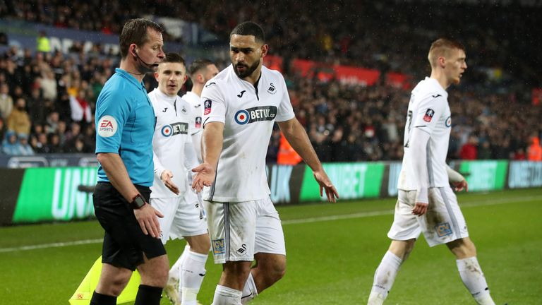 Swansea's players protest City's late winner