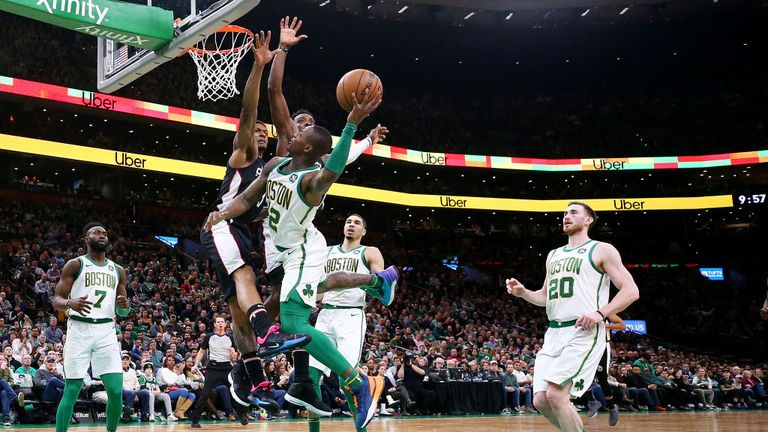 Terry Rozier of the Boston Celtics takes a shot against Bradley Beal of the Washington Wizards