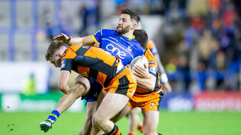 Toby King is tackled by Castleford's Jake Trueman and Matt Cook