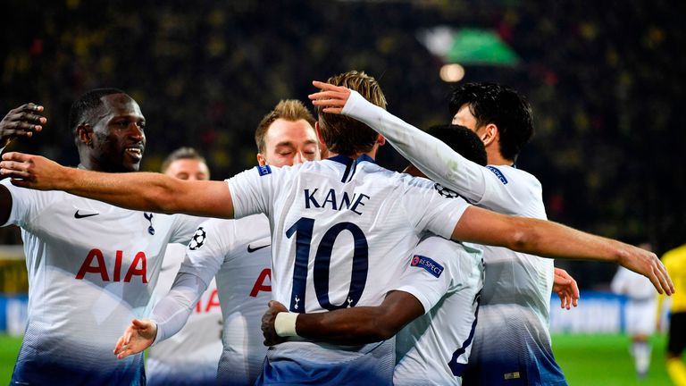 Kane is mobbed by team-mates after making it 1-0