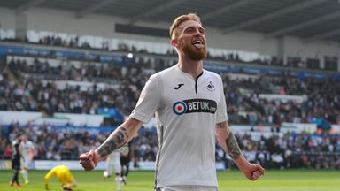 Oli McBurnie celebrates scoring Swansea's fourth goal during the Sky Bet Championship match against Rotherham United