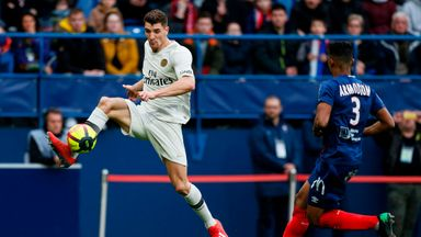 Thomas Meunier controls the ball under pressure from Yoel Armougom