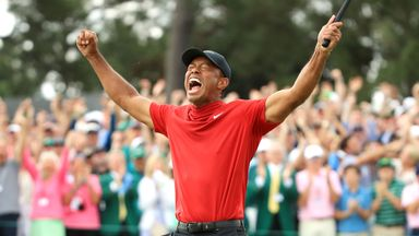 Tiger Woods celebrates after sinking his putt to win The Masters 2019