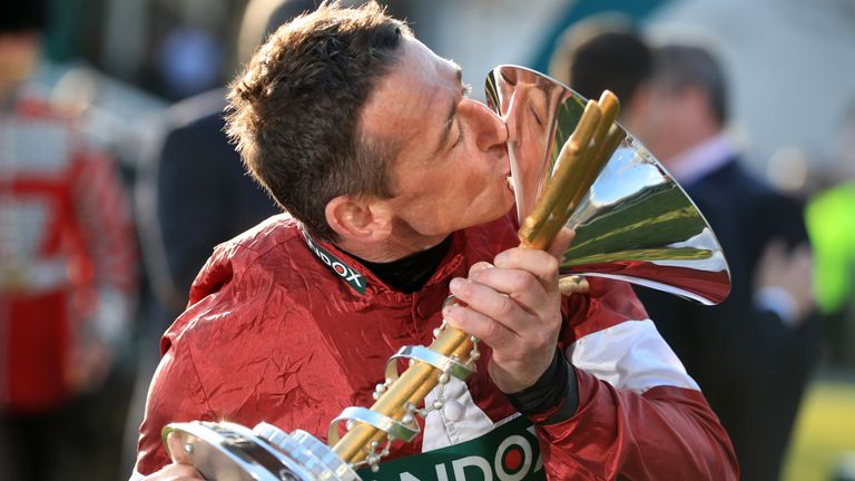 Jockey Davy Russell celebrates with the trophy after Tiger Roll's second Grand National win