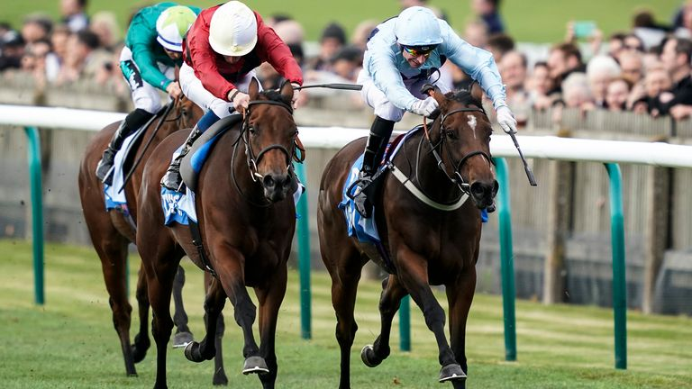 William Buick riding Mot Juste (left)  to win at Newmarket
