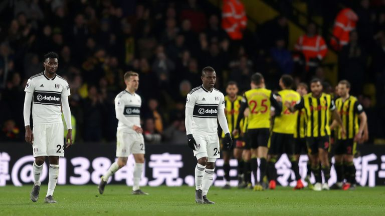 Fulham's Andre Zambo Anguissa and Jean Michael Seri look dejected