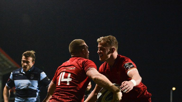 Andrew Conway celebrates with team-mate Mike Haley after scoring Munster's fifth try