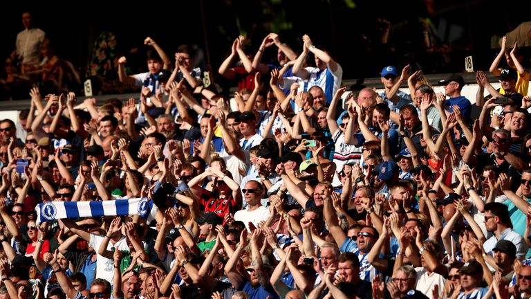 Brighton fans celebrate at the final whistle after the Seagulls earned a second away clean sheet this term
