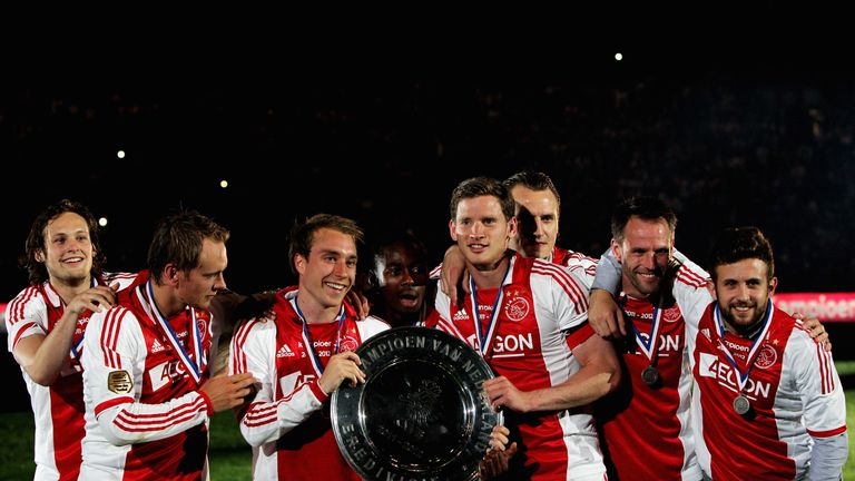 Enoh Eyong with Eriksen and Vertonghen celebrating the  Eredivisie win in 2012