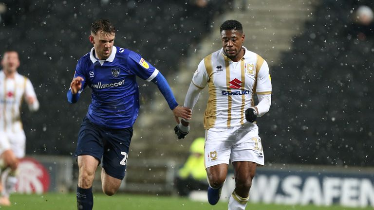 MK Dons midfielder Chuks Aneke was allegedly subjected to racist abuse on social media