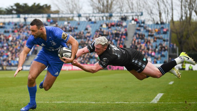 Dave Kearney of Leinster on his way to scoring his side's first try despite the tackle of Stuart Hogg