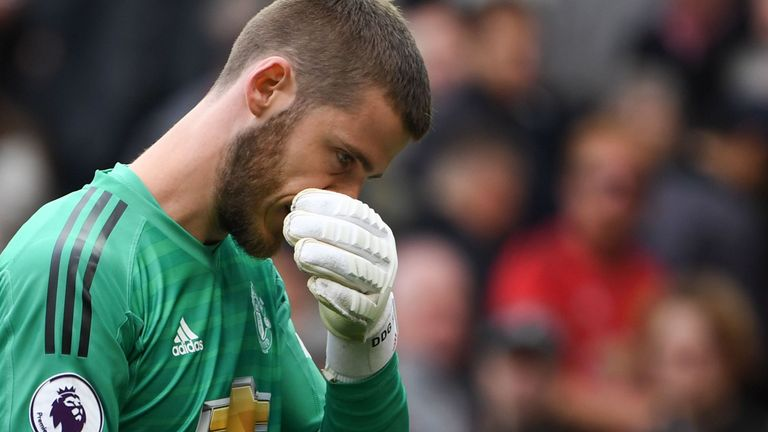 De Gea looks to the ground after his mistake late in the first half