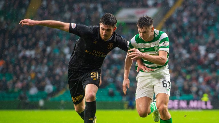 Livingston's Declan Gallagher (left) jostles with Celtic defender Kieran Tierney