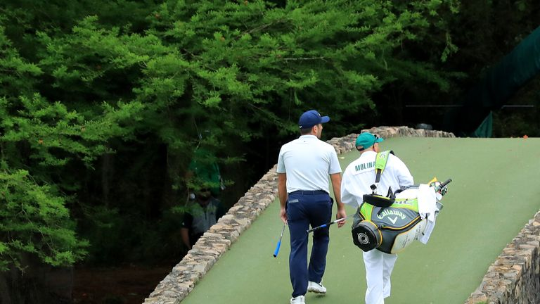 Molinari briefly held a three-shot lead when Woods posted back-to-back bogeys on the front nine