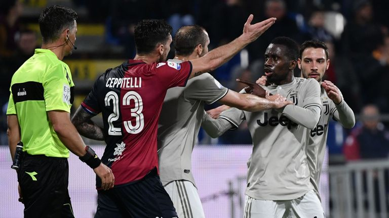 Giorgio Chiellini (centre) attempts to calm down Blaise Matuidi (second right) who reacted after Cagliari's fans threw bottles towards Moise Kean