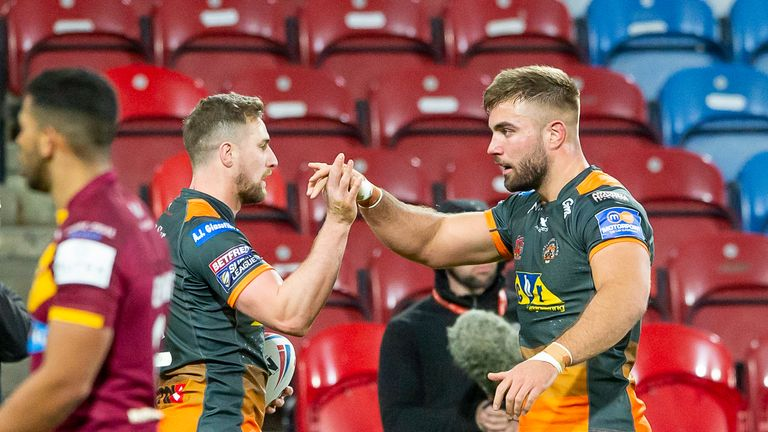James Clare is congratulated on his try against Huddersfield by Mike McMeeken