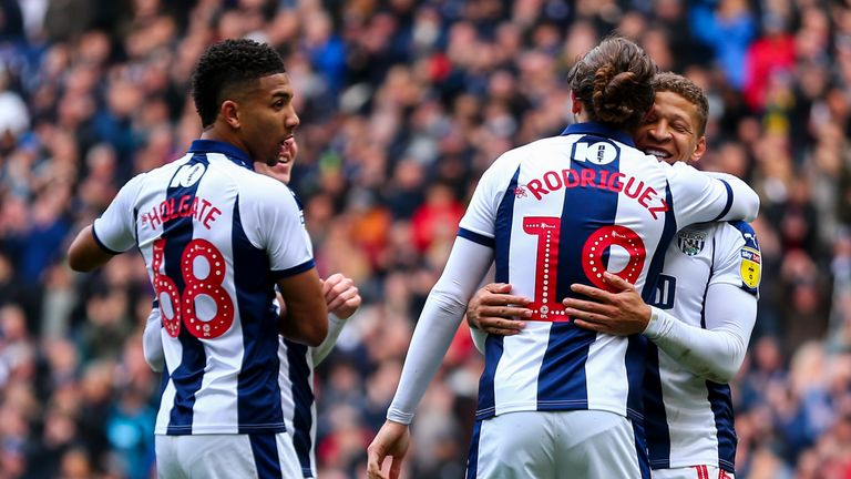 Jay Rodriguez celebrates with strike partner Dwight Gayle after making it 3-0