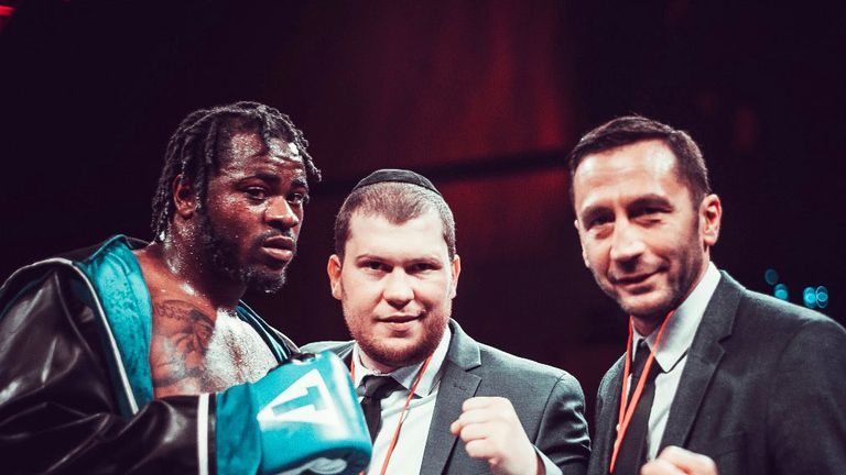 Jermaine Franklin celebrates his 18th win with promoter Dmitriy Salita (Pic by Terrell Groggins)