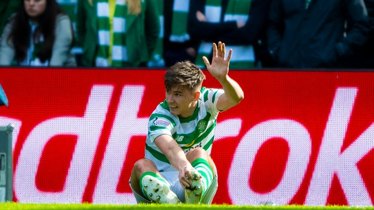Celtic's Kieran Tierney suffers an injury in the second half against Rangers