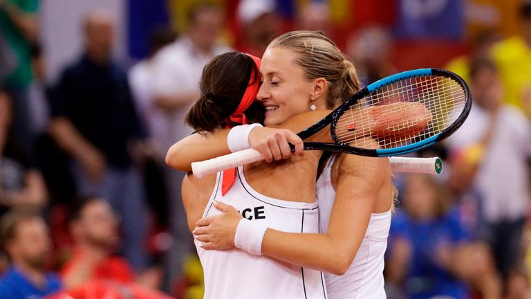Kristina Mladenovic and Caroline Garcia celebrate their victory