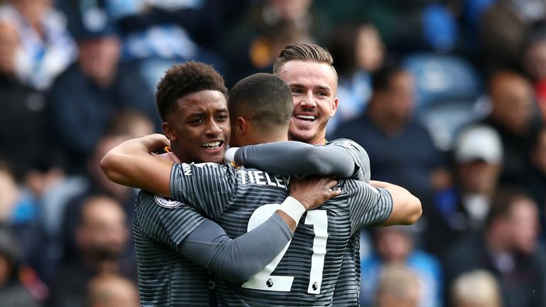 Youri Tielemans is congratulated after opening the scoring against Huddersfield