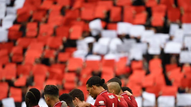 Liverpool players observed a minute's silence before the match