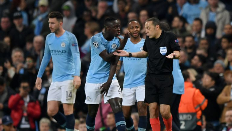 Man City players protest with referee Cuneyt Cakir after he rules out Sterling's late winner