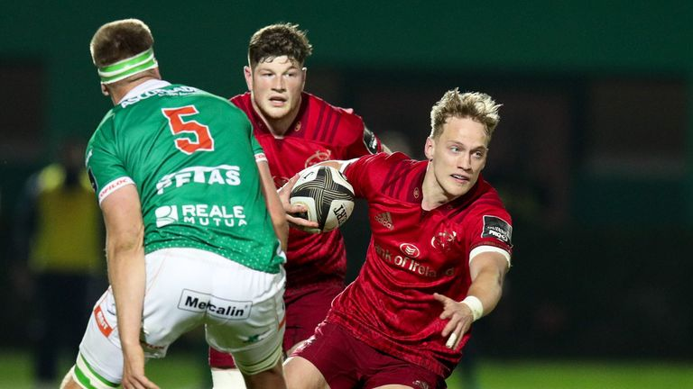 Mike Haley of Munster takes on Federico Ruzza of Benetton Treviso