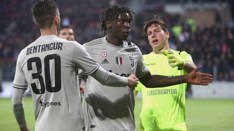 Rodrigo Bentancur attempts to guide Juventus team-mate Moise Kean away from Cagliari fans who racially abused him