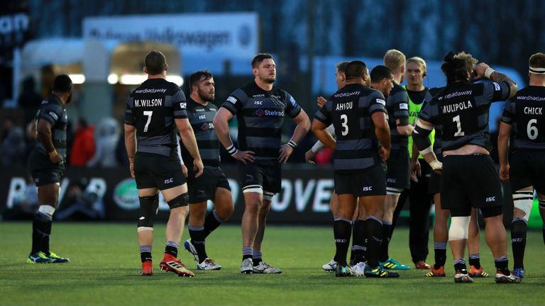 Newcastle Falcons players look dejected after losing to Northampton
