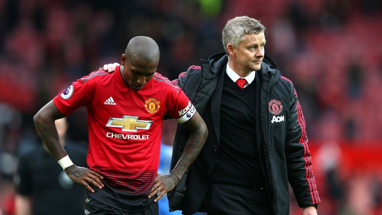 Ole Gunnar Solskjaer consoles Ashley Young following the 1-1 draw with Chelsea