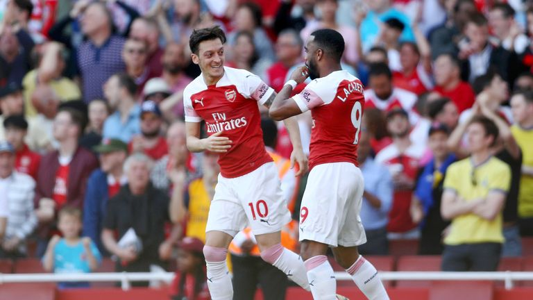 Mesut Ozil and Alexandre Lacazette celebrate following Ozil's equaliser against Crystal Palace during the Gunners' 3-2 defeat