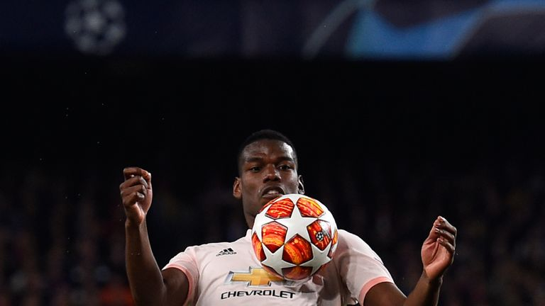 Paul Pogba chests the ball down