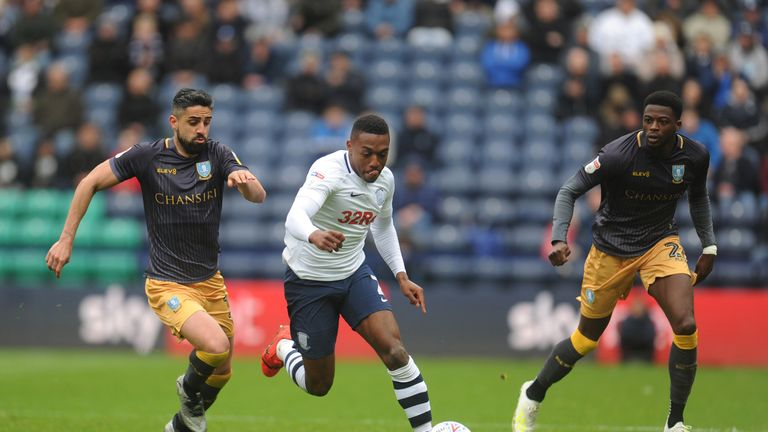 Preston North End's Darnell Fisher under pressure from Sheffield Wednesday's Marco Matias